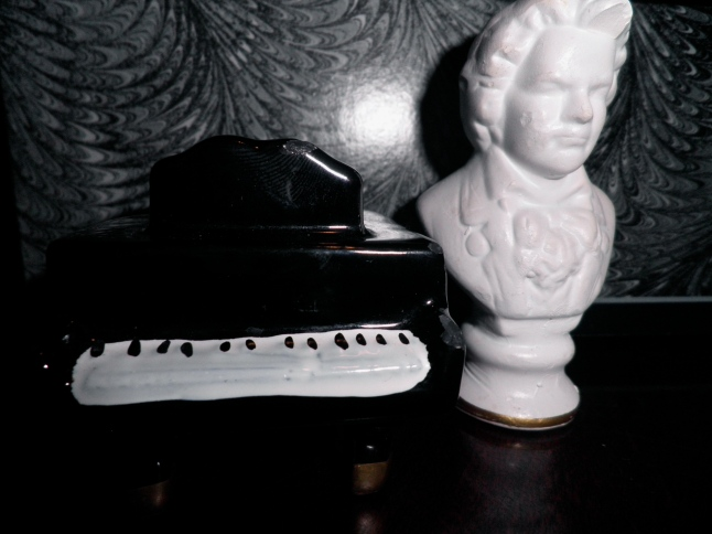 Salt and pepper shakers that Caleb's family got for us from a yard sale in DC! Beethoven and his piano :)