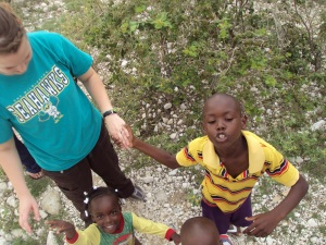 The boy in the yellow is the one who would put my hand on his head, and the little girl is the one I gave my bracelet to :)
